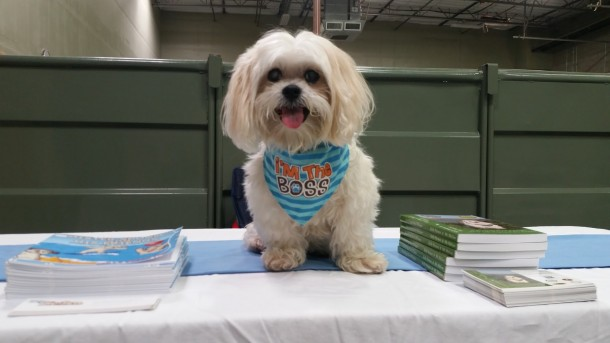 Mr MaGoo ready to sign books at Camp Bow Wow Peoria AZ