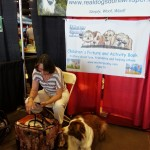 Customer relaxing at our booth Phoenix Pet Expo